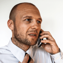 Image of man talking on the phone